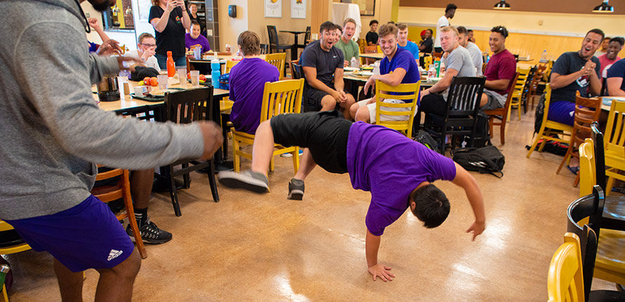 Light House member Alex Morrison break dances in the dining hall.