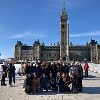 Laurier's International Students Overcoming War club discuss mission with federal politicians in Ottawa