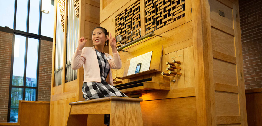 Charlotte plays the organ
